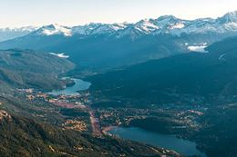 Fly over the Whistler Blackcomb resort in a helicopter.