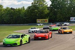 Racing a Ferrari or Lamborghini on a real racing circuit!
