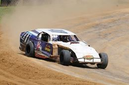 Drift around the dirt track driving a race car at St. Louis.