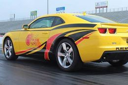 Experience the thrill of flying down the drag strip at Atlanta Dragway in a Camaro SS.