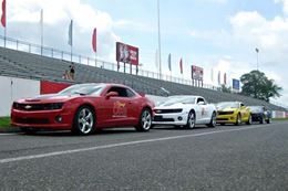 Experience the thrill of flying down the drag strip at Gainesville Raceway in a Camaro SS.