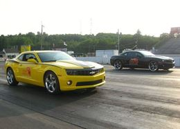 Experience the thrill of flying down the drag strip at Houston Raceway Park in a Camaro SS.