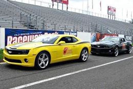 Race down the drag strip in a Camaro Side-by-Side competition at Dallas's Texas Motorplex.