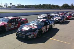Buckle up and drive a NASCAR style race car at Colorado National Speedway, Denver